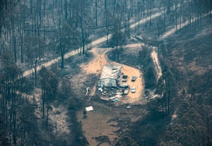 An aerial view of fire destruction along the Great Alpine Road at Sarsfield, Victoria