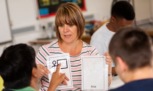 Charlotte Travers shows pupils cards during a sex education class at Oak Field school in Nottingham.