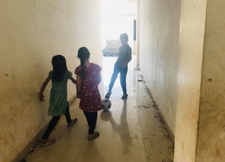 Hazara children playing football in the hallway of the former military building in Kalideres.