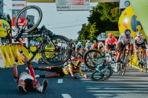 Dutch cyclist Dylan Groenewegen and fellow riders collide during the opening stage of the Tour of Poland.