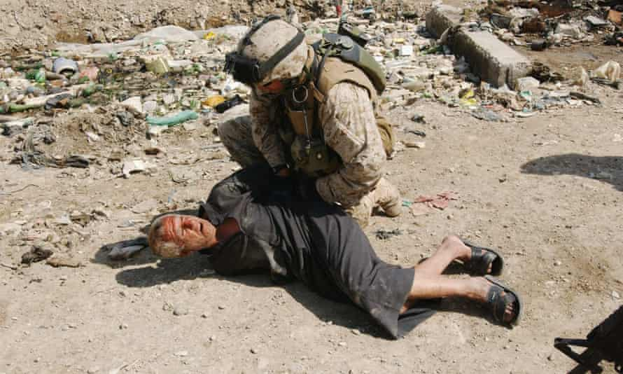 A US marine arrests an Iraqi man on 23 March 2005 in Ramadi, one of the cities worst affected by terror attacks.