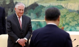 The US secretary of state, Rex Tillerson, looks on as China's President Xi Jinping walks to his seat during a meeting at the Great Hall of the People in Beijing on Saturday.