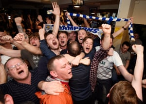 Supporters celebrate inside the Market Tavern