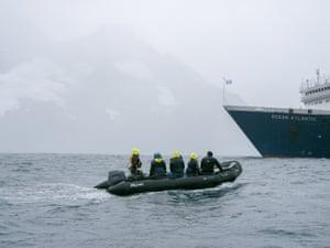 "Staff return to the ship in a ""zodiac"""