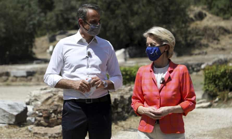 Kyriakos Mitsotakis and Ursula von der Leyen walk during their meeting at the ancient agora in Athens