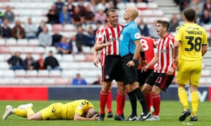 Lee Cattermole is about to be booked against Fleetwood. 'There were probably 16 different opinions on Lee,' says Jack Ross.
