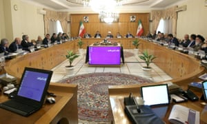 Iran's president Hassan Rouhani (centre at rear) in a cabinet meeting 8 May, in Tehran, Iran.