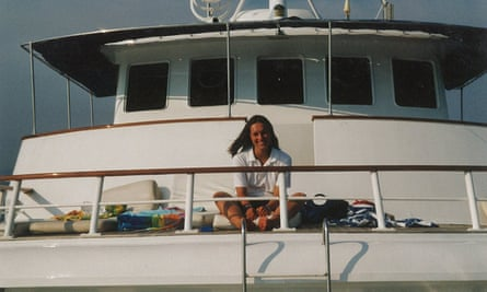 Charlotte Drury sitting in the sunshine on a yacht.