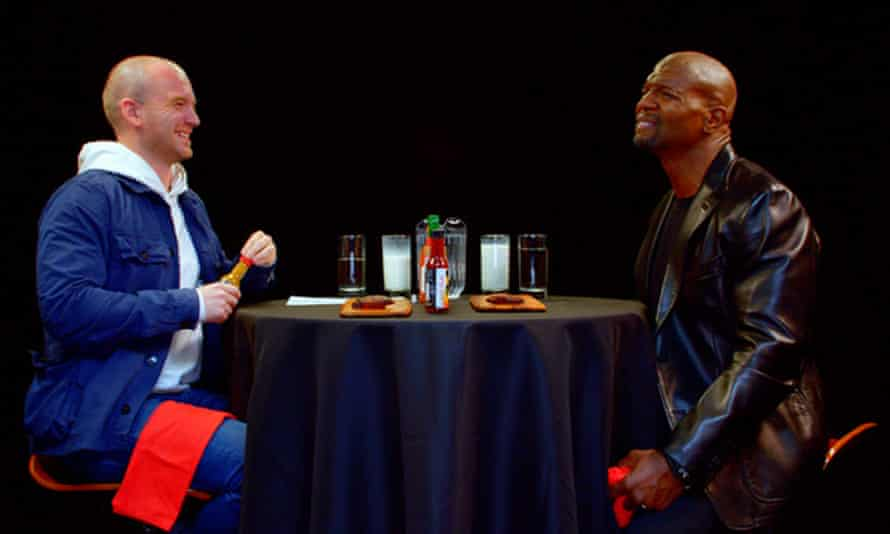 Terry Crews feels the burn on Hot Ones.