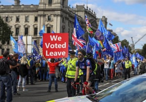 """A pro-Brexit supporter holds up a sign saying """"We Voted Leave"""" at an anti-Brexit protest at Parliament Square on 3 September"""
