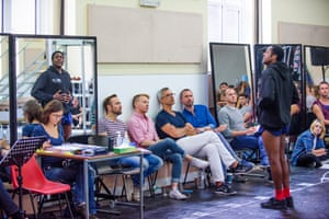 Director and choreographer Jerry Mitchell, wearing glasses, centre, watches Matt Henry (Lola) in rehearsal for Kinky Boots