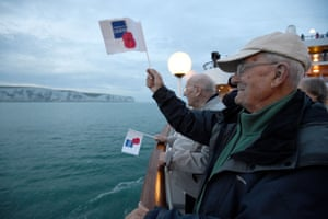 Veterans wave flags from the MV Boudicca to mark the 75th anniversary of D-day