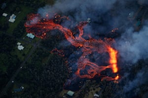 Volcanic activity continues on Kilauea's east rift zone, as a robust fissure eruption in Leilani Estates sends a massive flow into the subdivision, consuming all in its path