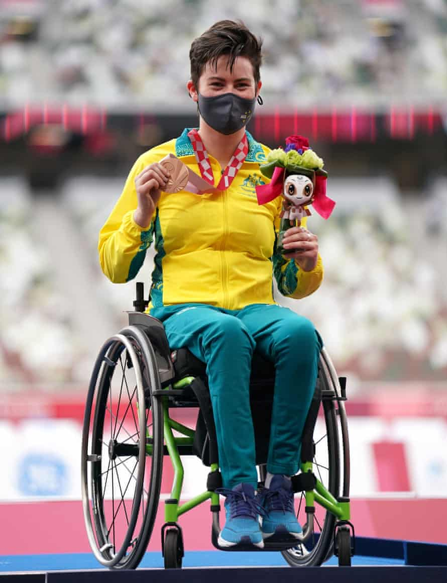 Australia's Robyn Lambird poses with her bronze medal after finishing third in the women's 100 metres T34 final.