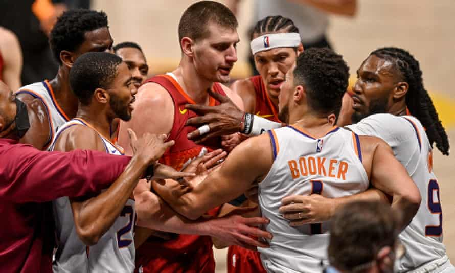 Nikola Jokic and Devin Booker exchange words after a play that would result in the NBA MVP being ejected from Sunday's game