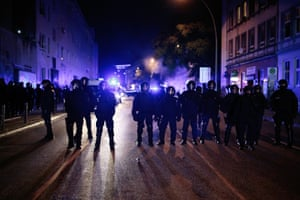 Anti-riot police clash with protesters in Schanzenviertel, the night before the summit