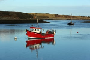 Boats at anchor near Sketrick Castle, on Strangford Lough, County Down. A new BBC series Bloodlands is expected to encourage more tourists to visit Northern Island.