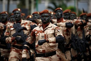 Abidjan, Ivory Coast. Special force soldiers participate in a parade at the presidential palace to commemorate the country's Independence Day
