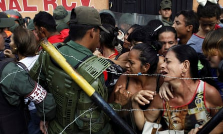 Venezuelans clash with national guards as they try to cross the border to Colombia at Urena to spend their soon-to-be-scrapped bolivar bills.