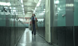 Hope walks along the corridors of the New York storage facility where Ruth's belongings were stored, on her way to look at them for the first time since her sister's death six years earlier.