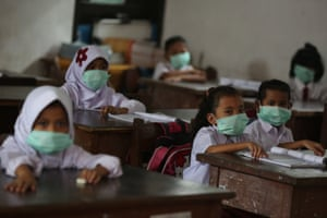 Schoolchildren wear masks
