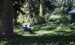 Person sitting in Les Quatre Saisons garden, France.