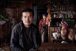 Jimbu Sherpa and his wife Kanchi Sherpa, inside their lodge at Thadepati Pass, Nepal