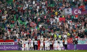 Olympique Lyonnais players applaud their fans.