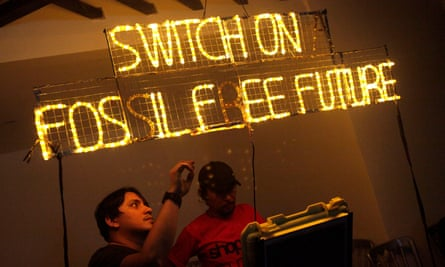Volunteers set up an LED banner for Earth Hour last year.