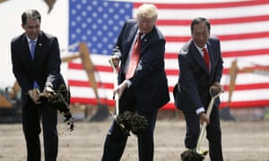 Donald Trump, center, along with Governor Scott Walker, left, and the Foxconn chairman, Terry Gou, participate in a groundbreaking event for the proposed new Foxconn facility in Mt Pleasant, Wisconsin in June 2018.