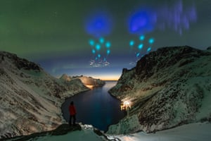 People and space. Highly commended: Azure Vapor Tracers by Yang Sutie (China) At the top of fjords in Arctic Norway, the photographer was met with an unknown sky. Was it aliens? Was it the supernatural? He captured a series of photos to record the night and didn't know until the next day that the colours were actually created by the auroral zone upwelling rocket experiment from Andoya Space Centre, which dispersed gas tracers to probe winds in Earth's upper atmosphere