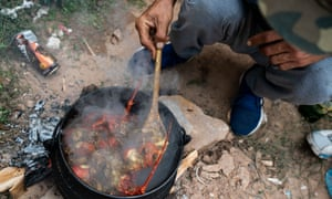 Poachers cooking an abalone and shellfish stew