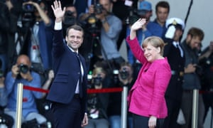 Emmanuel Macron with Angela Merkel in Berlin.