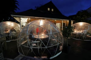 People socialise inside plastic bubbles at the St Villa bar and restaurant in St Albans, Hertfordshire, United Kingdom.