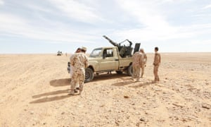 Libyan soldiers stand at a military outpost in Wadi Bey, west of the Islamic State-held city of Sirte, February 23, 2016.