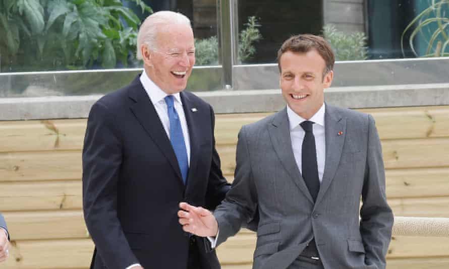 Biden and Macron share a joke together