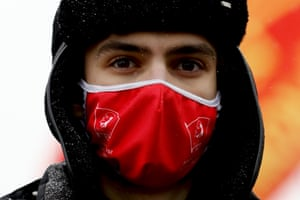 A man wearing a mask attends the commemoration ceremony