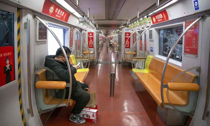 Riding the subway in Beijing.
