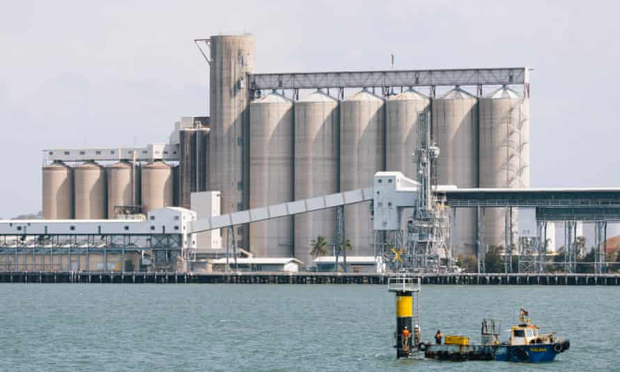massive silos by the water