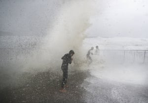 Children are soaked by huge waves at Bronte beach in Sydney on Sunday.