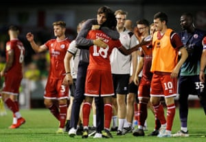 Crawley Town manager Gabriele Cioffi embraces David Sesay at the end of the match.