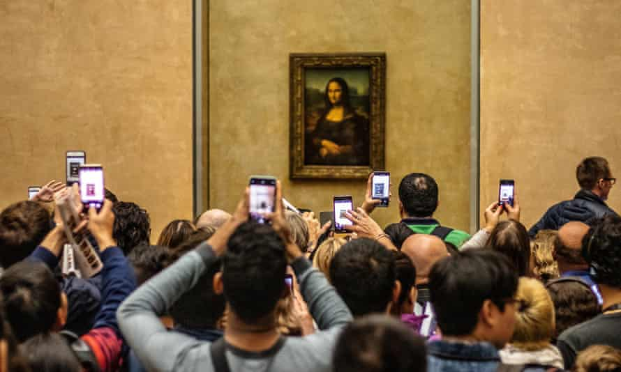 Don't moaner Lisa? Tourists at the Louvre in Paris.