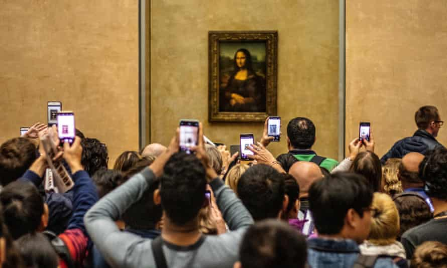 Timed for selfies … the Mona Lisa at the Louvre.