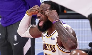 LeBron James celebrates after the Lakers defeated the Miami Heat to clinch the NBA title