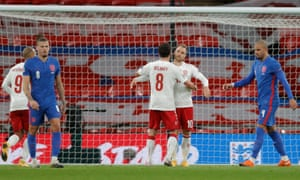 Christian Eriksen of Denmark (second right) celebrates after opening the scoring from the penalty spot.