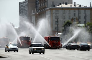 Moscow, Russia: Vehicles spray water over Sadovoye Koltso Street to stop the tarmac overheating.