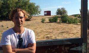 Gabriel Wrye in his garden overlooking Rob Rhinehart's container.