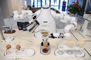 An Orion Star robot prepares coffee in Beijing, China