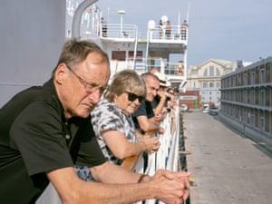 Australian passengers of the Ocean Atlantic watch on as non-Australians disembark the vessel