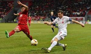 Liverpool's James Milner crosses against Rubin Kazan